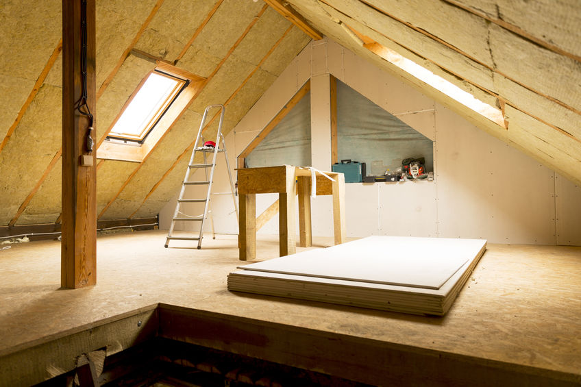 house attic under construction mansard wall insulation with rock