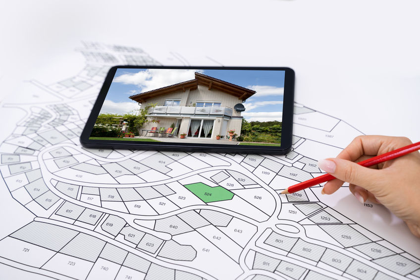 Hand Holding Pencil Over Cadastre Map New Tablet